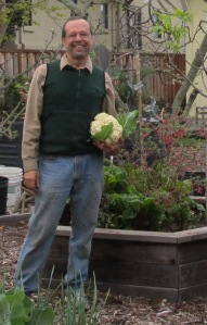 Me holding the last of this year's cauliflowers.